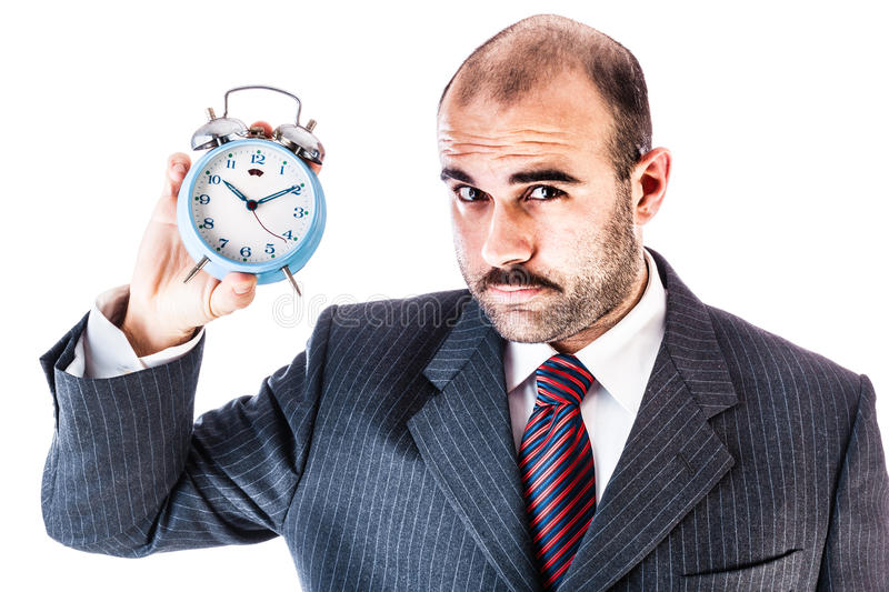 Businessman with alarm clock stock image