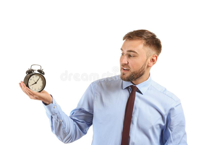 Businessman with alarm clock on white background royalty free stock photo