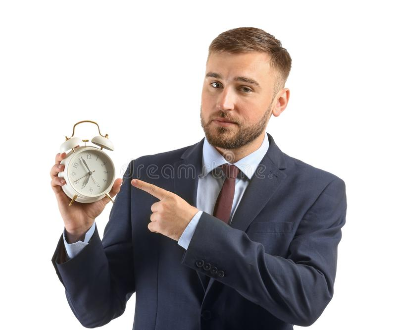 Businessman with alarm clock on white background royalty free stock images