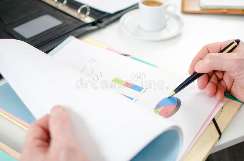Businessman analysing a financial graph royalty free stock image
