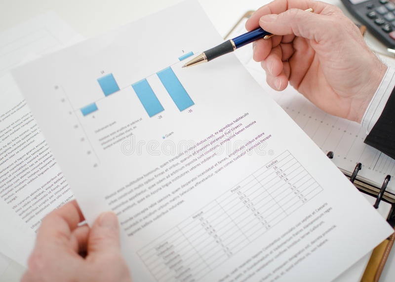 Businessman analysing a graph royalty free stock image