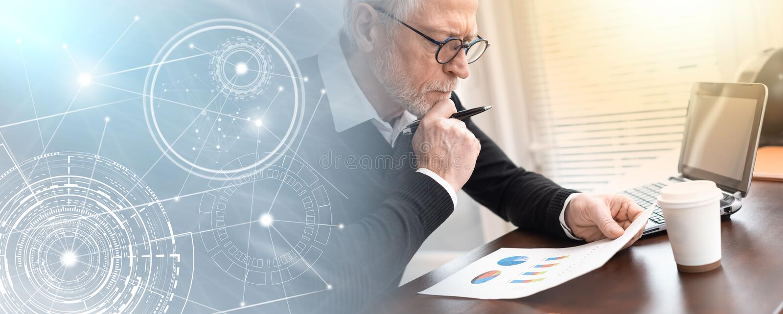 Businessman analysing marketing graphs; panoramic banner. Senior businessman analysing marketing graphs at office; panoramic banner royalty free stock photos