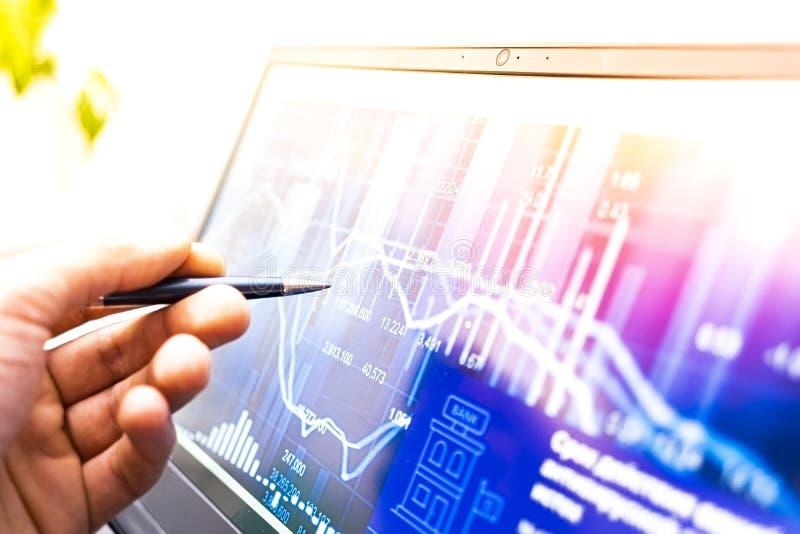 Businessman analysing share prices stock photos