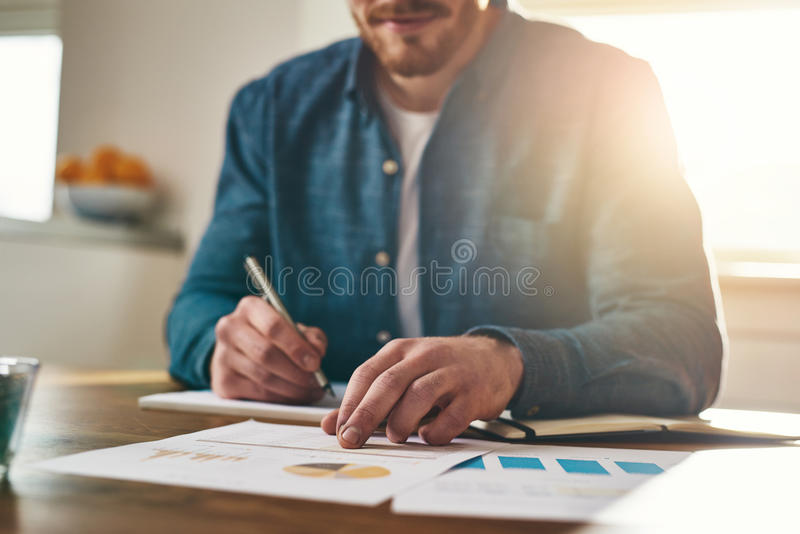 Businessman analysing statistical charts stock images