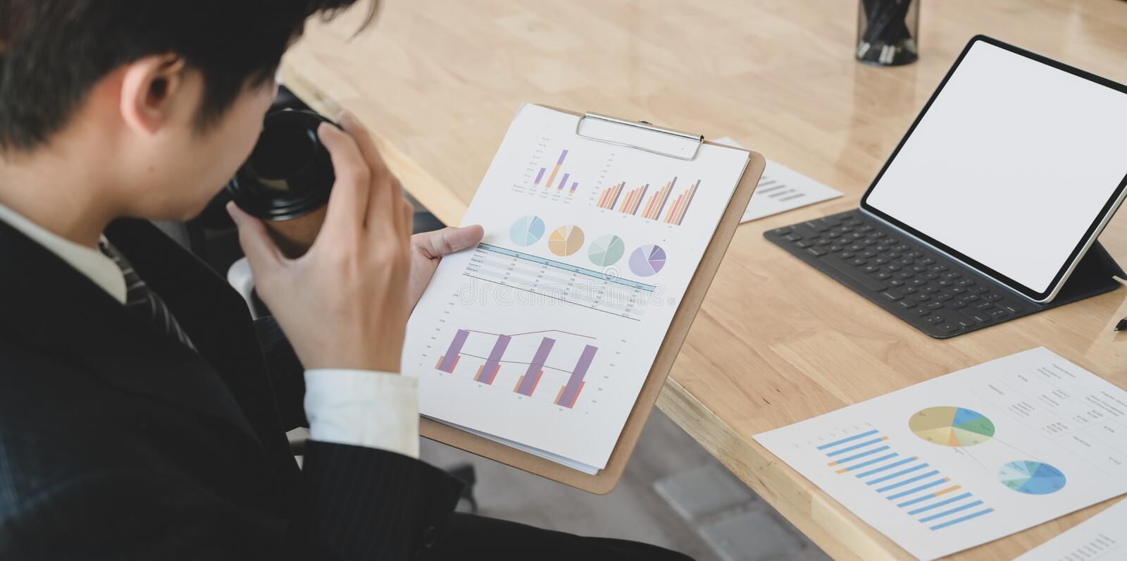 Businessman analysing the strategic with charts and graphs on the document stock image