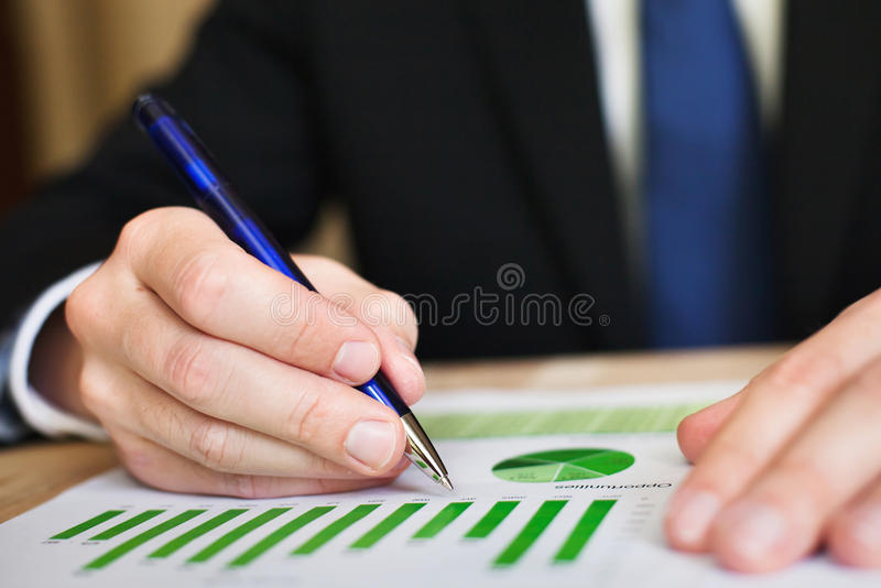 Businessman Analyzes Chart Royalty Free Stock Images