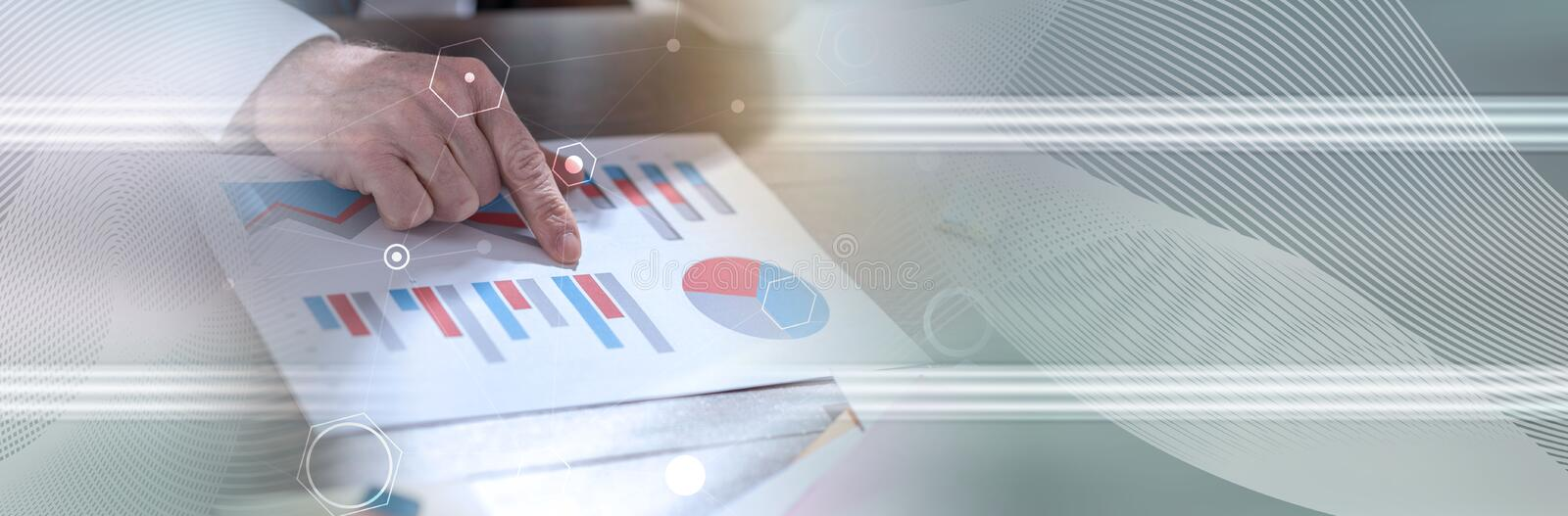 Businessman analyzing financial data, double exposure, light effect; panoramic banner. Businessman analyzing financial paperwork, double exposure, light effect stock photos