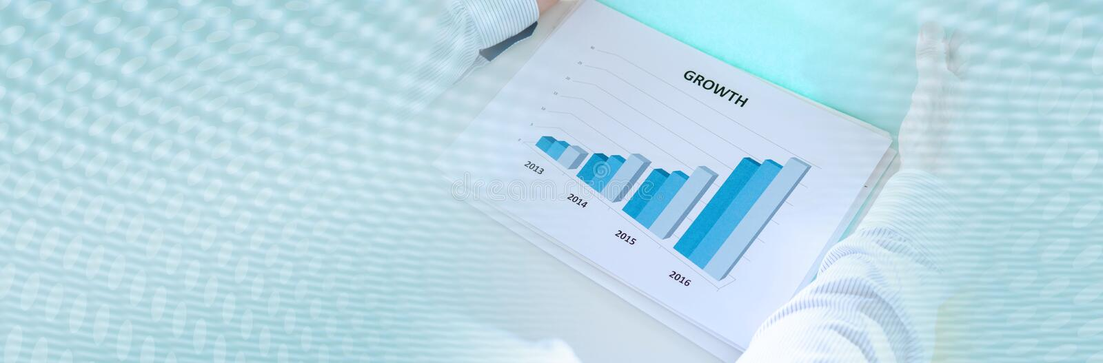 Businessman analyzing a graph. panoramic banner. Businessman analyzing a graph showing growth. panoramic banner stock photos