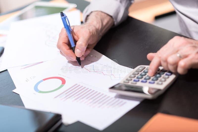 Businessman analyzing graphics stock photography