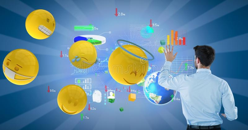 Businessman analyzing graphs on blue background by various emojis stock photo