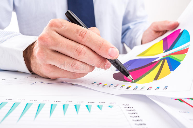 Businessman analyzing pie chart. stock images