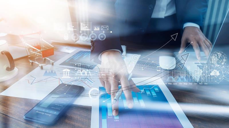 Businessman analyzing sales data and economic growth and pointing at business report document with icon and graph financial stock photos
