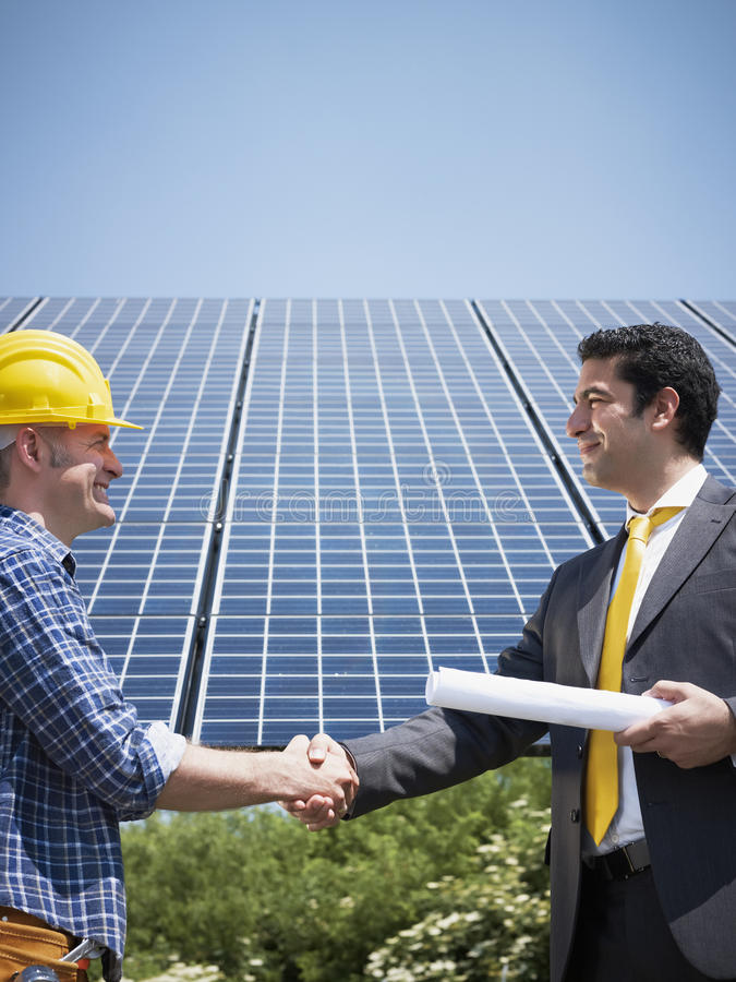 Free Businessman And Electrician Shaking Hands Stock Photo - 14518480