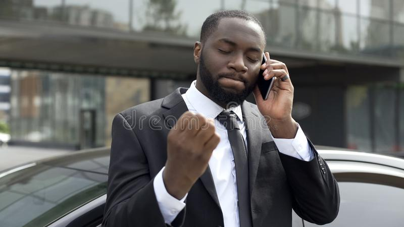 Businessman annoyed by unpleasant phone conversation, problems in business royalty free stock images