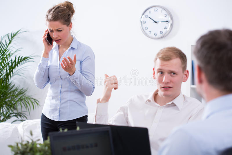 Businessman and annoying colleague royalty free stock images