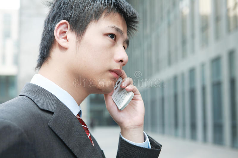 Download Businessman  Is Answering Phone Outdoor Stock Image - Image: 14063495