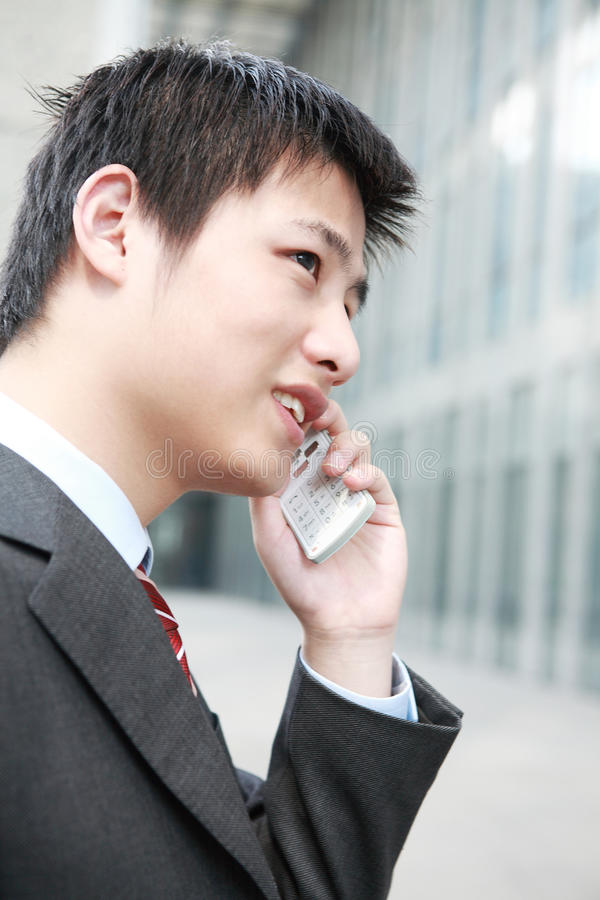 Download Businessman  Is Answering Phone Outdoor Stock Photo - Image: 14063504