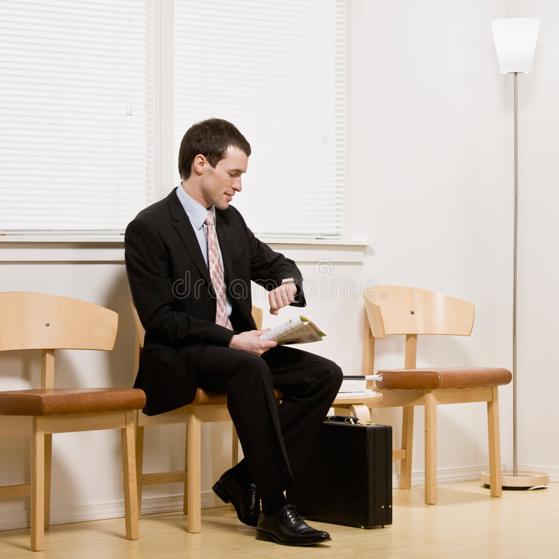 Businessman anxiously waiting for appointment. Or interview in office waiting area royalty free stock photos