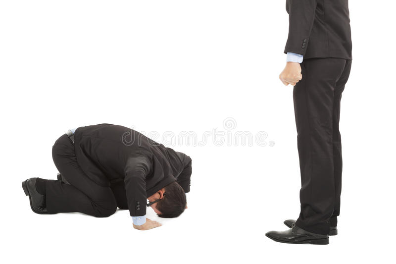 Businessman apologize to boss with japanese kneeling position royalty free stock photos