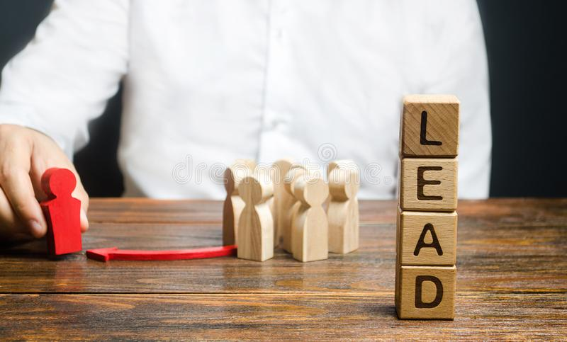 A businessman appoints a group of people a new leader. Appointment of a head to form a team. Project leadership. Distribution. Of duties. Career growth royalty free stock images