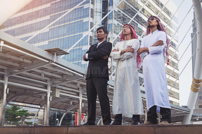 Businessman and Arab businessmen worker on construction stock photography