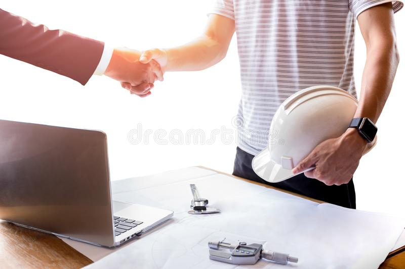 Businessman and Architect engineer shaking hands teamwork success concept royalty free stock images