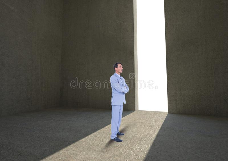 Businessman with arms crossed by doorway stock images