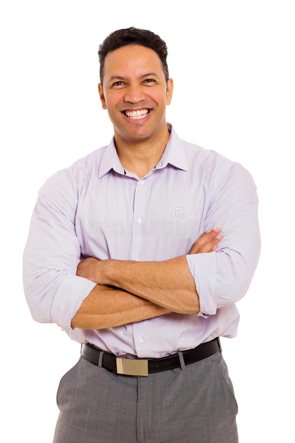 Businessman with arms folded. Handsome middle aged businessman with arms folded stock photography