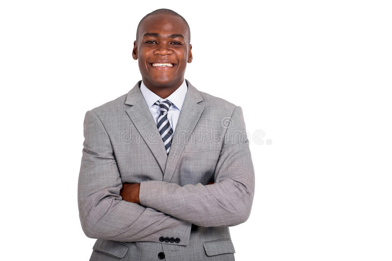 Businessman with arms folded. Portrait of businessman with arms folded royalty free stock photos