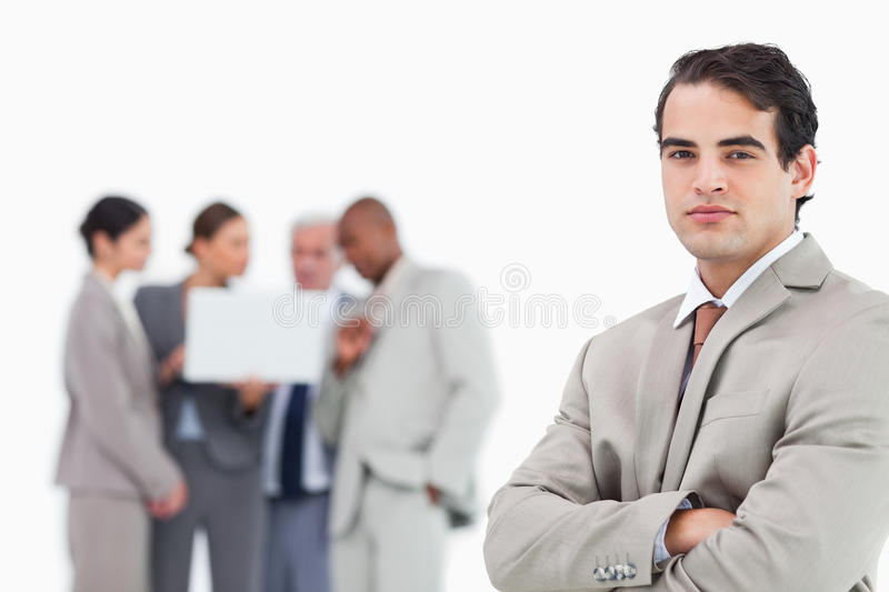 Download Businessman With Arms Folded And Team Behind Him Stock Image - Image: 22859203