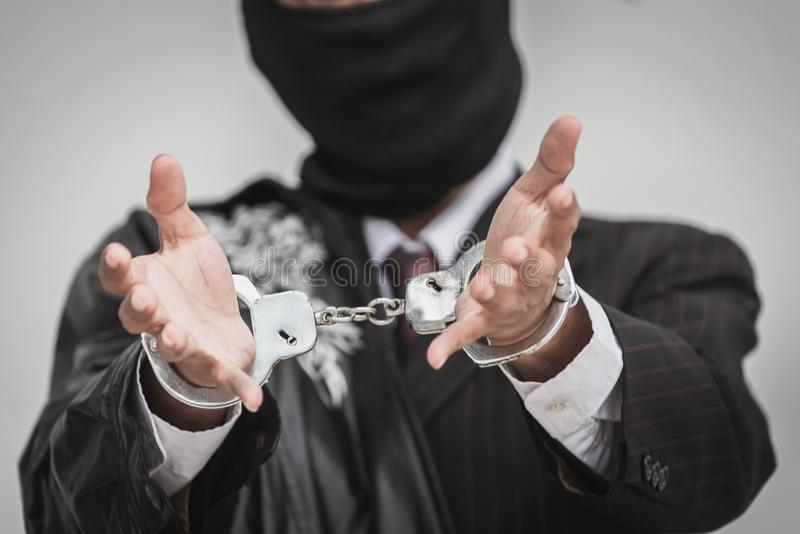 Businessman arrested with handcuffs for money euro money bank fraud and bribery. hands wide open stock photography