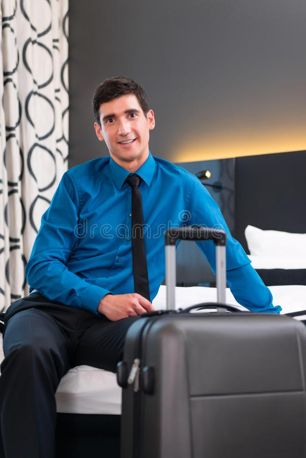 Businessman at arrival in hotel room. Businessman at arrival in room of design hotel stock images
