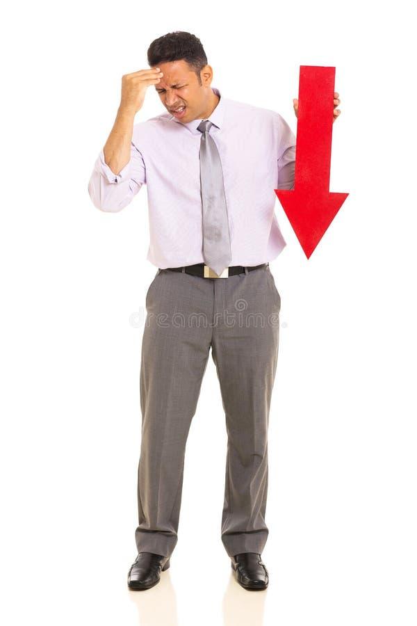 Businessman arrow pointing down stock image
