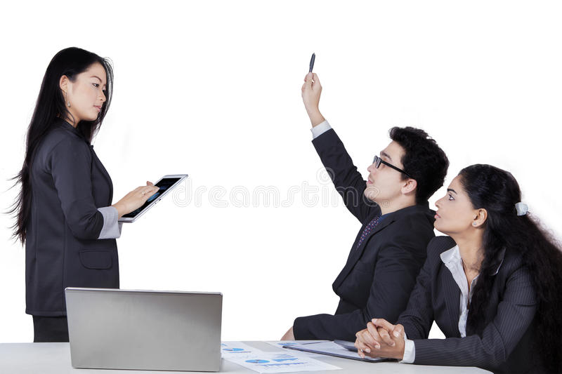 Businessman asking to the meeting leader. Portrait of caucasian businessman raise hand to ask at the meeting leader, isolated on white royalty free stock photo