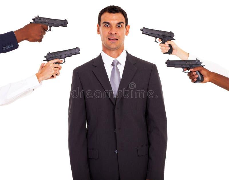 Businessman attacked gun stock photos