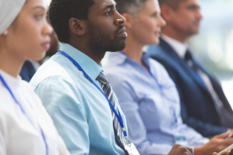 Businessman attending a business seminar royalty free stock image