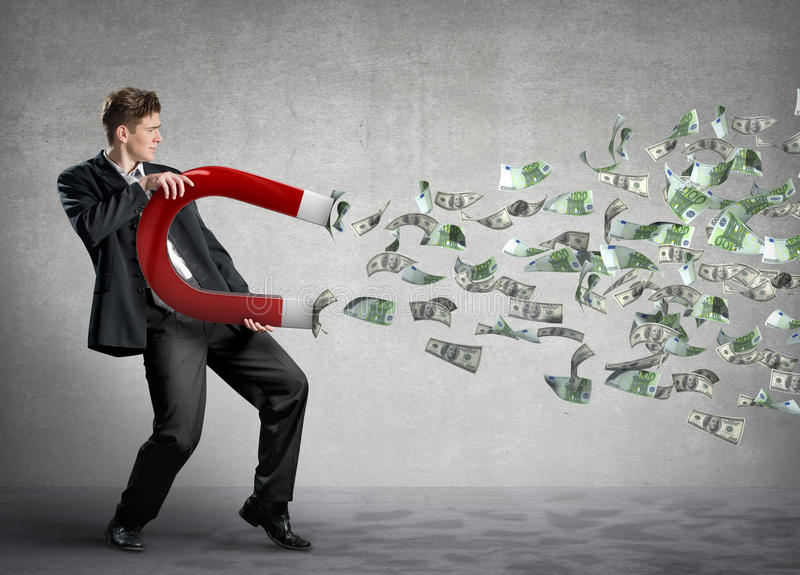 Businessman attracts money stock image