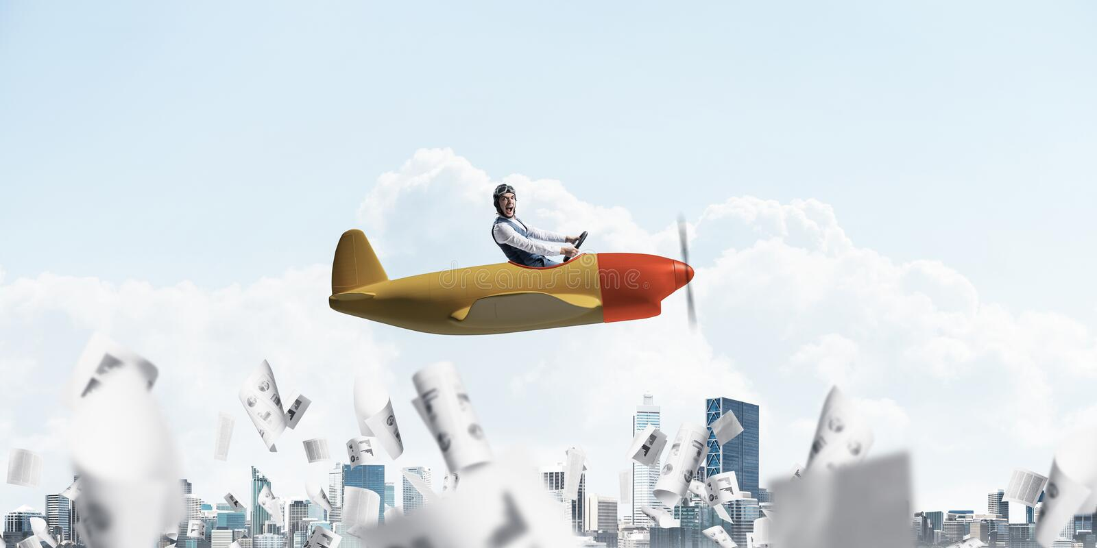 Businessman in aviator hat driving plane. Businessman in aviator hat and goggles driving propeller plane above cityscape. Papers falling down on background of royalty free stock image