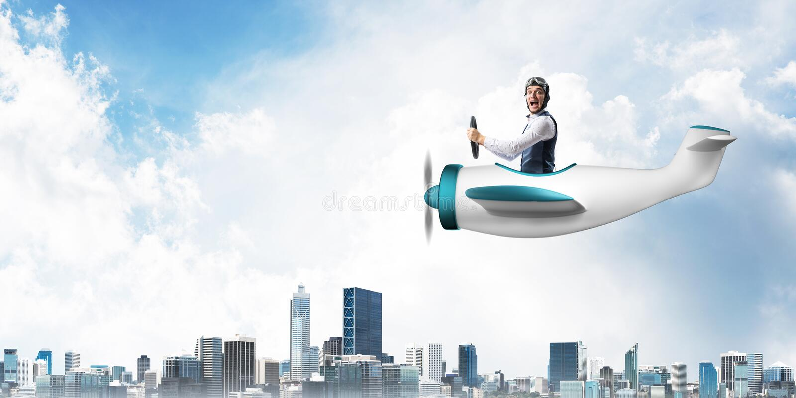 Businessman in aviator hat and goggles royalty free stock image