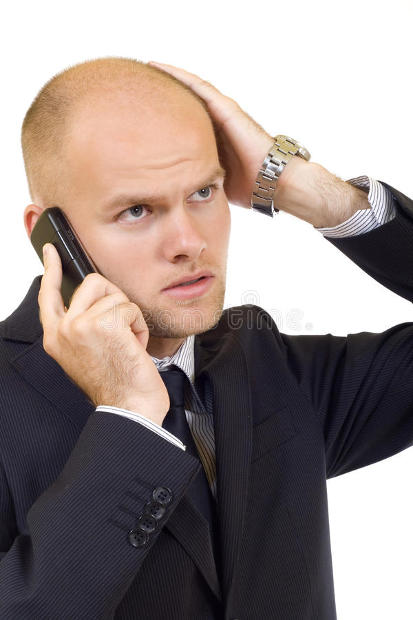Businessman with bad news on his cell phone royalty free stock photo