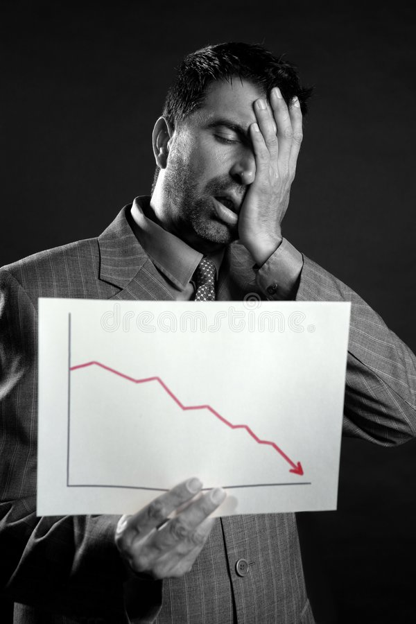 Businessman with bad sales reports chart stock photography