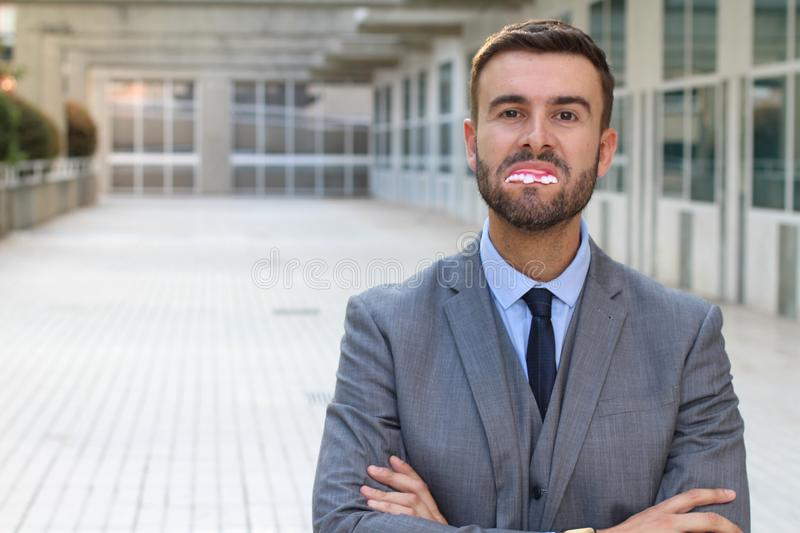 Businessman with really bad teeth.  stock photography