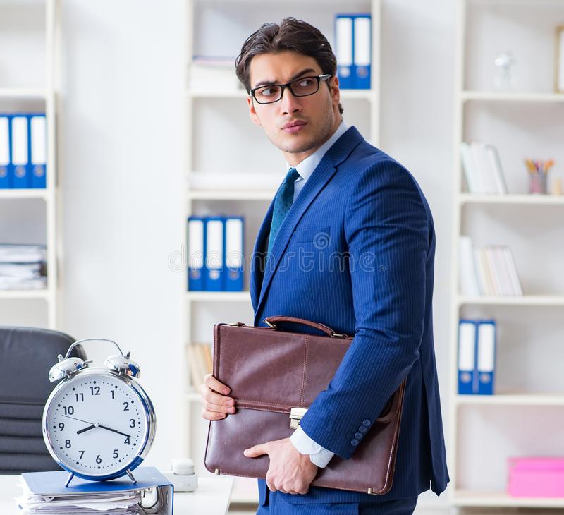 Businessman in bad time management concept. The businessman in bad time management concept stock photos