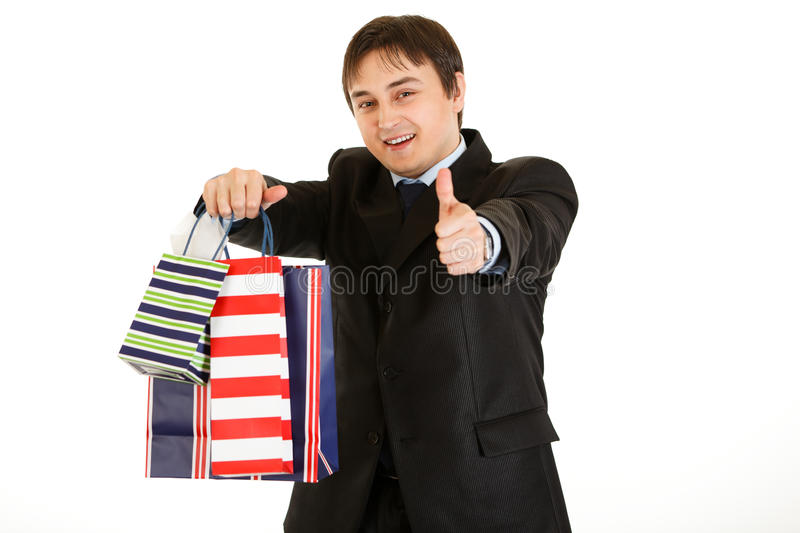 Businessman With Bags And Showing Thumb Up Gesture Royalty Free Stock Photo