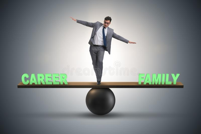 Businessman balancing between career and family in business conc. Ept stock photo