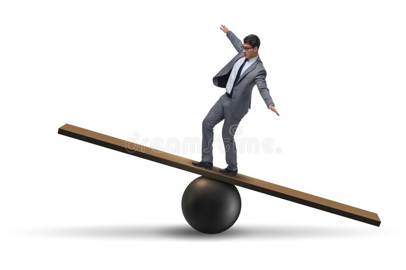 The businessman balancing on seesaw in uncertainty concept. Businessman balancing on seesaw in uncertainty concept stock images