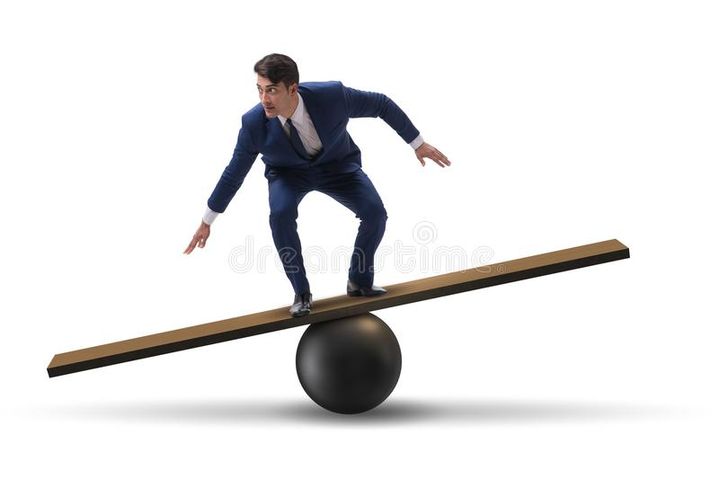 The businessman balancing on seesaw in uncertainty concept. Businessman balancing on seesaw in uncertainty concept royalty free stock photo