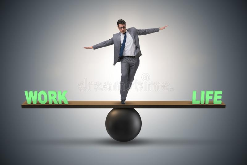 The businessman balancing between work and life in business concept stock images