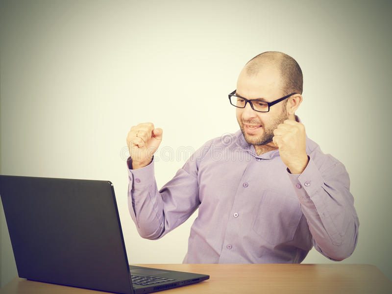 Businessman bald with beard wearing shirt and glasses royalty free stock photo