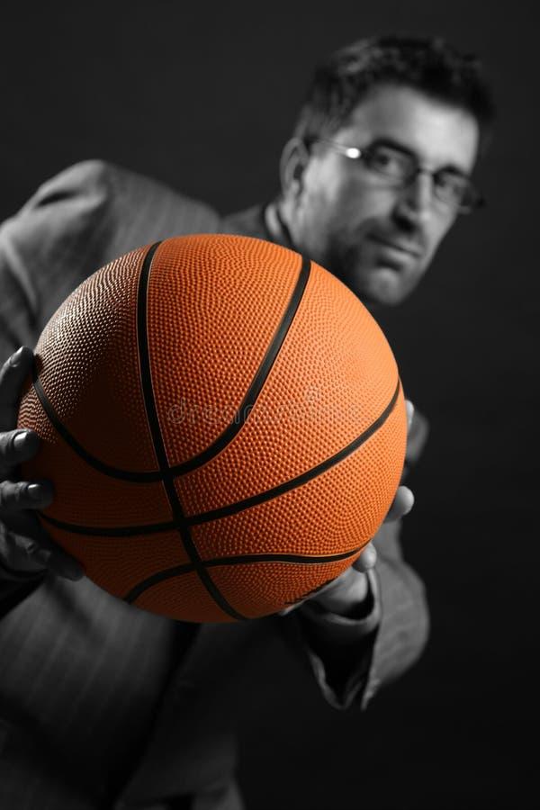 Businessman with basketball ball, teamwork royalty free stock photo
